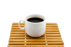 Cup of coffee on a wooden stand isolated on a white background Stock Image
