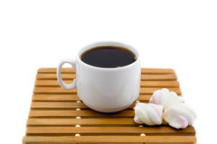 Cup of coffee on a wooden stand with marshmallows isolated on a white background Stock Photos
