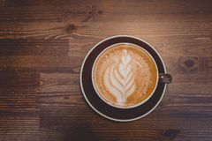 A cup of coffee on wooden surface. Morning time with cappuchino Stock Photography