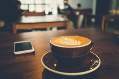 A cup of coffee on wooden surface.  Stock Photo
