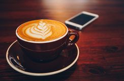 A cup of coffee on wooden surface.  Royalty Free Stock Photos