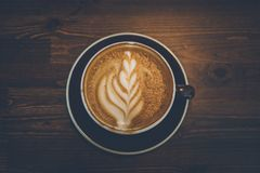 A cup of coffee on wooden surface.  Stock Image