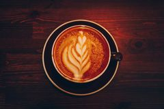 A cup of coffee on wooden surface. Morning time with cappuchino Royalty Free Stock Images