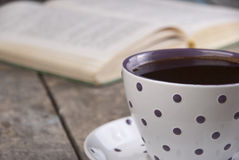Cup of coffee on a wooden table. Close up photo Royalty Free Stock Photo