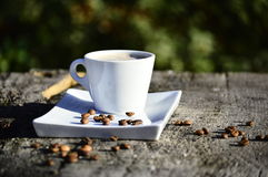 Cup of coffee on a wooden table. In daylight Stock Photos