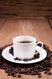 Cup of coffee. Coffee cup on a wooden table Royalty Free Stock Images
