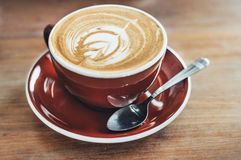 A cup of coffee. On wooden table Stock Photography