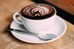 A cup of coffee. On wooden table Stock Images