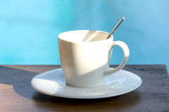 Cup of coffee  on a wooden table Royalty Free Stock Images