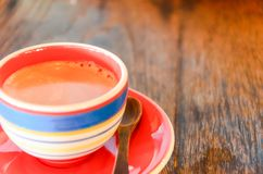 Cup of coffee. Coffee on a wooden table royalty free stock photography