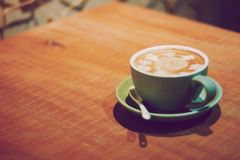 Cup of coffee on wooden table  Stock Images