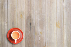 Cup of coffee on wooden table background Stock Photography