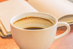 A cup of coffee on wooden table. A cup of coffee on wooden table backgroung Royalty Free Stock Photography