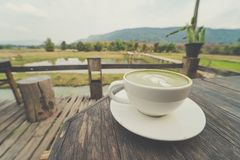 Cup of coffee on wooden table. With  beautiful natural background Stock Image