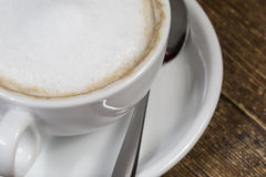 Cup of coffee on the wooden table Royalty Free Stock Photos
