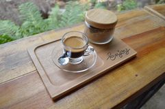 A cup of coffee on wooden table. Coffe cup on wooden table Royalty Free Stock Images