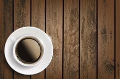 Cup of coffee on a wooden table. Royalty Free Stock Photos