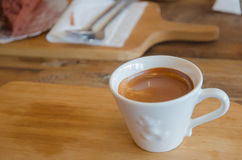 Cup of coffee on wooden table Royalty Free Stock Photo