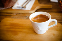 Cup of coffee on wooden table Royalty Free Stock Image