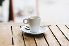 Cup of coffee on a wooden table. A cup of coffee on a wooden table in a European coffee shop. Italian breakfast Royalty Free Stock Photography