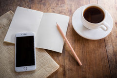Cup of coffee on a wooden table Stock Image
