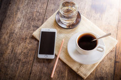 Cup of coffee on a wooden table Stock Photos