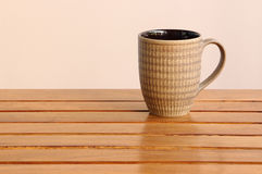 Cup of coffee on wooden table. In hotel Stock Photography