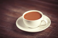 Cup of coffee on wooden table. Stock Images