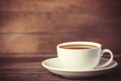 Cup of coffee on wooden table. Royalty Free Stock Photos