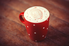 Cup of coffee on wooden table. Royalty Free Stock Photography