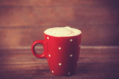 Cup of coffee on wooden table. Stock Image