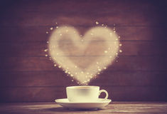 Cup of coffee on wooden table. Royalty Free Stock Image