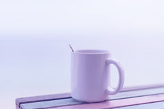 Cup of coffee on wooden table with retro filter effect Stock Photos