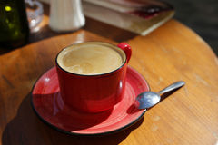 Cup of coffee on the wooden table Stock Photography