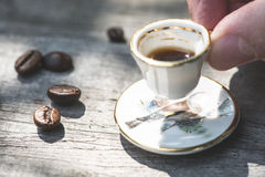 Cup of coffee on wooden table Stock Photo