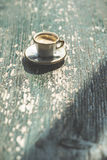 Cup of coffee on wooden table. Small miniature cup Royalty Free Stock Photo