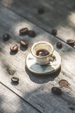 Cup of coffee on wooden table. Small miniature cup Royalty Free Stock Photos