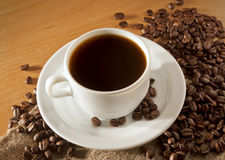 A cup of coffee on a wooden table top view Stock Photos