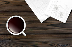 Cup of coffee on a wooden table Royalty Free Stock Image