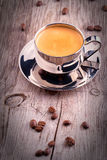 Cup of Coffee on wooden vintage table Royalty Free Stock Images