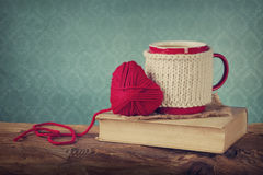 Cup of coffee and wool heart Royalty Free Stock Photography