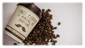 A cup of coffee. With the words `This coffee making me awesome` beside coffee bean royalty free stock photos