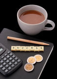 Cup of coffee with words success. And notebook, pencil, calculator, Thailand baht coins Royalty Free Stock Image