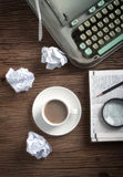 A cup of coffee on writers desk. A cup of coffee on wooden writers desk Stock Images