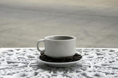 Cup of coffee on wrought iron garden table Royalty Free Stock Image