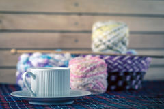 Cup of coffee and yarn balls. Cup of coffee and Knitting yarn balls with needles Stock Image