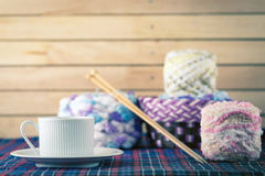Cup of coffee and yarn balls. Cup of coffee and Knitting yarn balls with needles Stock Photography