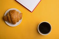 Cup of coffee on yellow background royalty free stock photography