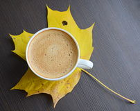 Cup of coffee with yellow leave Stock Photo