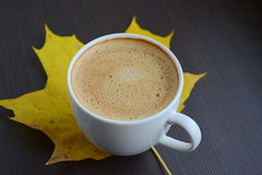 Cup of coffee with yellow leave Royalty Free Stock Photography
